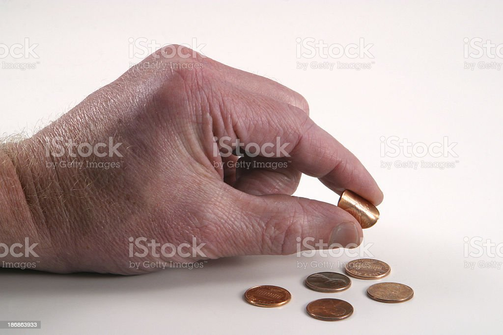 Pinching Pennies stock photo