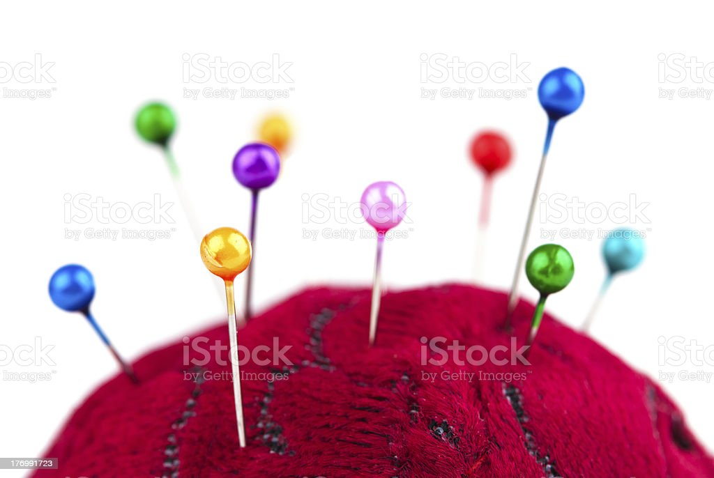 Pincushion with pins closeup royalty-free stock photo