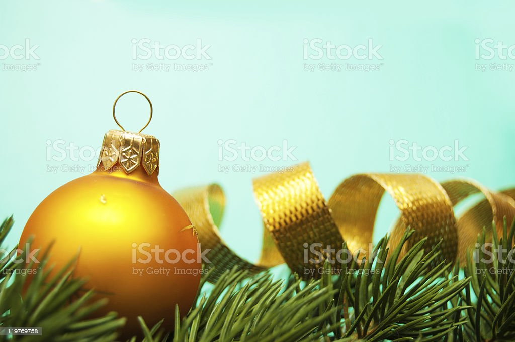 pine branches and christmas ball on turquoise background stock photo