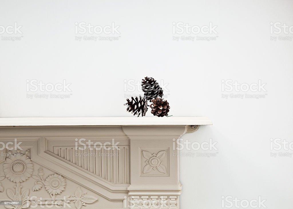 Pine cones on mantlepiece stock photo