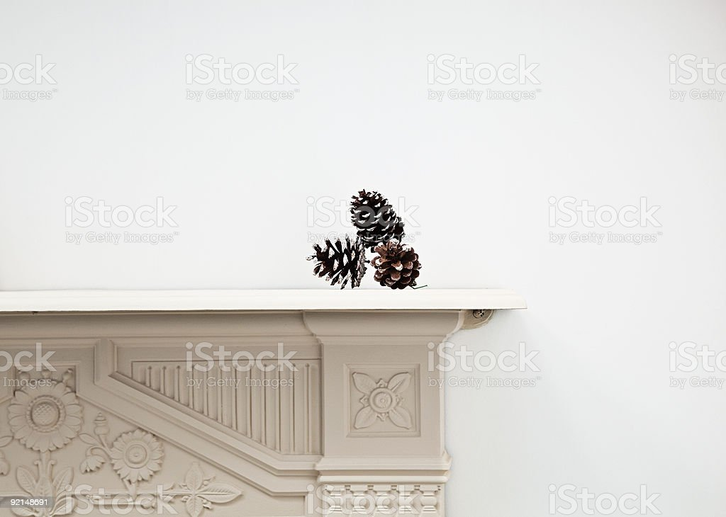 Pine cones on mantlepiece stock photo