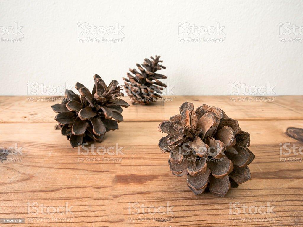 Pine cones on wood stock photo