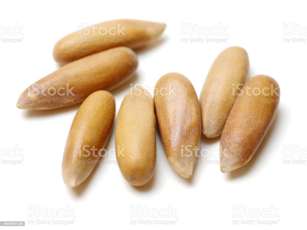 Pine Nuts from Brazil isolated on white background stock photo