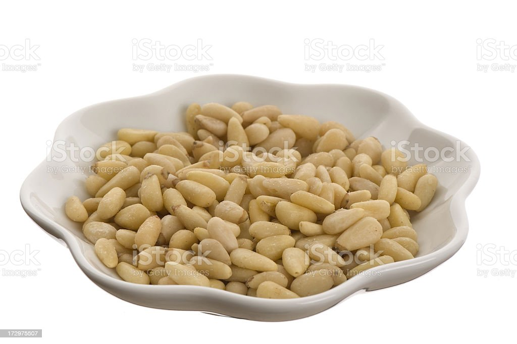 Pine nuts in a small white dish royalty-free stock photo
