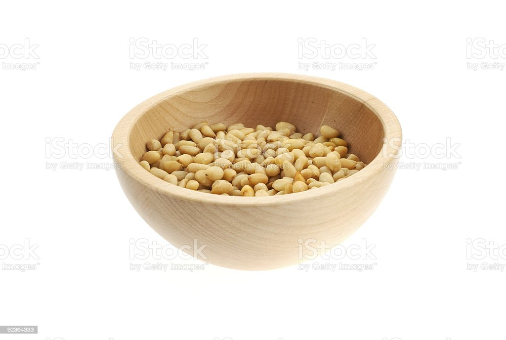 pine nuts in a wood bowl royalty-free stock photo