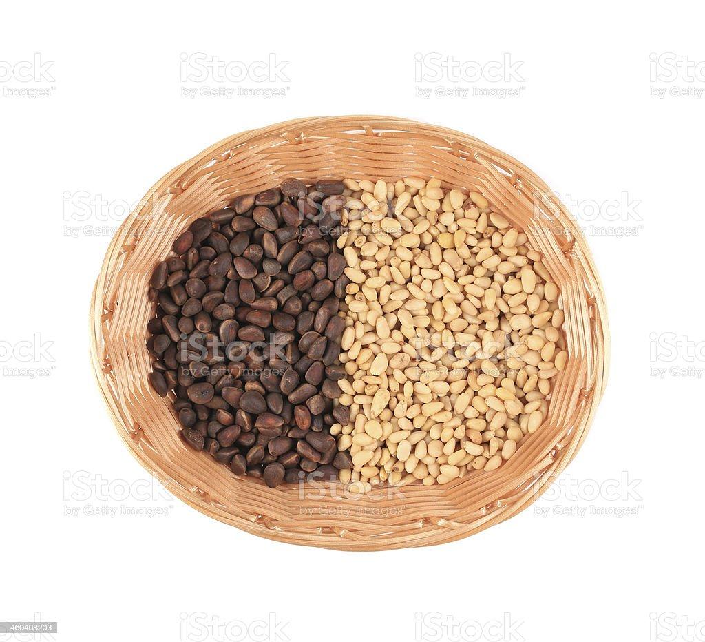 Pine nuts in wicker basket. stock photo