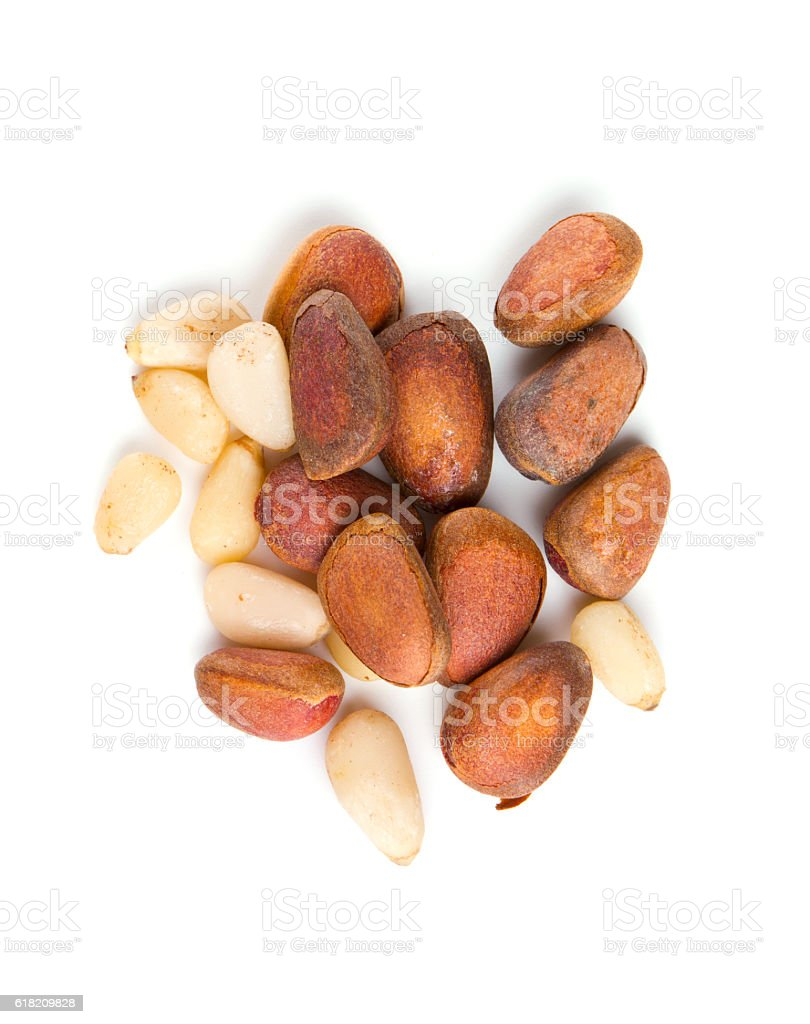 pine nuts isolated on white background stock photo