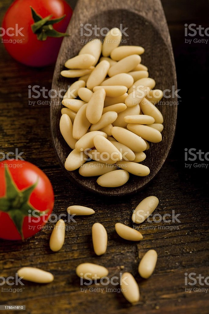 Pine nuts on wooden spoon royalty-free stock photo
