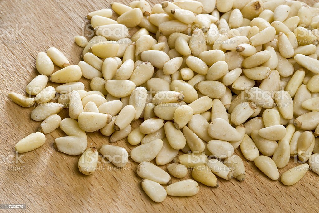 Pine nuts on wooden surface royalty-free stock photo