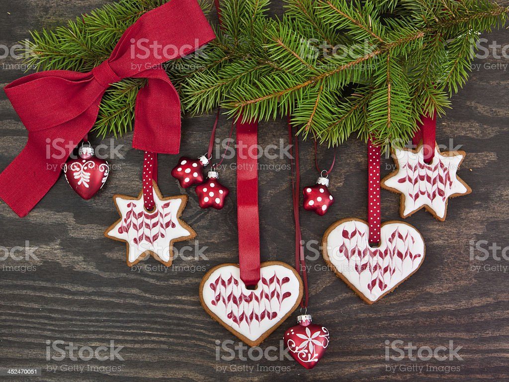 Pine tree branch with christmas cookies royalty-free stock photo