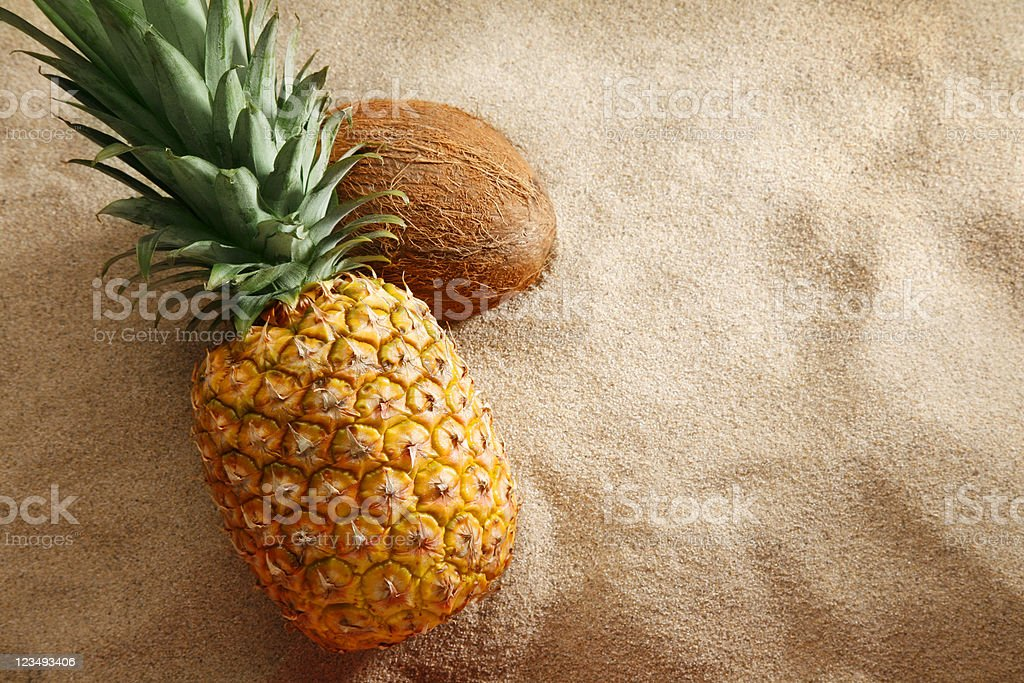 pineapple and coconut on the beach royalty-free stock photo