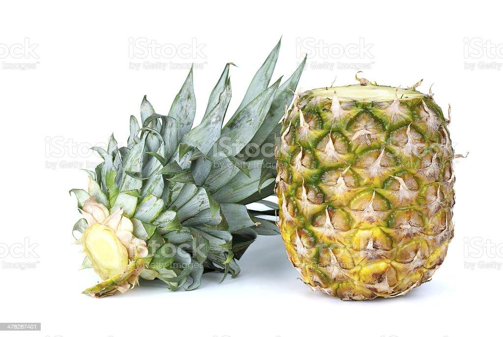 Ananás e cortadas-out folhas foto de stock royalty-free