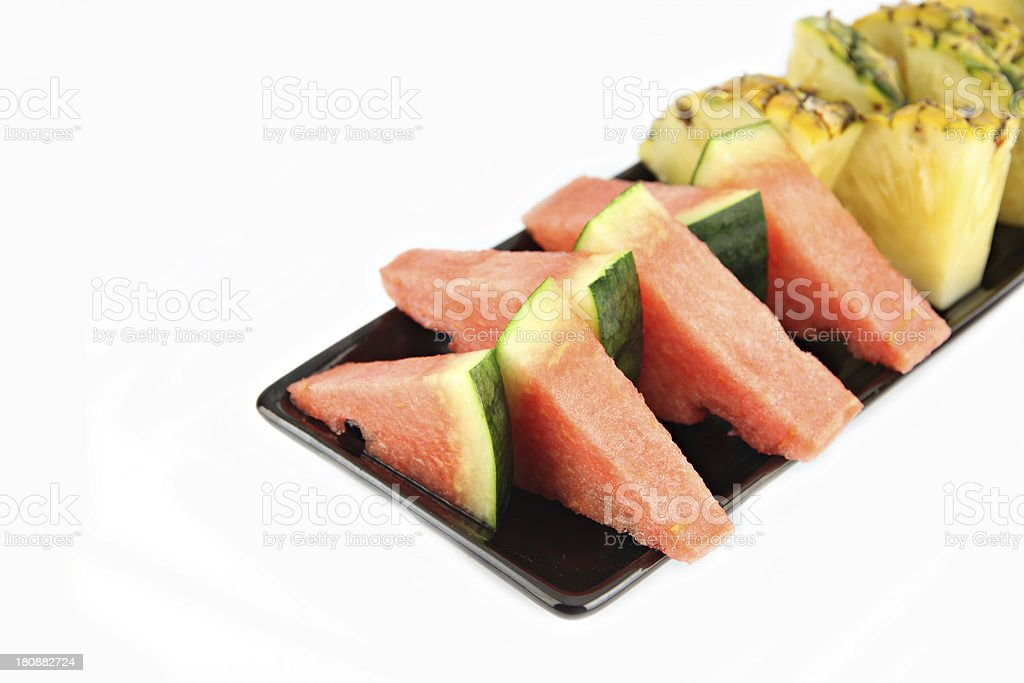Pineapple and Watermelon slice Arranged in the black dish. royalty-free stock photo