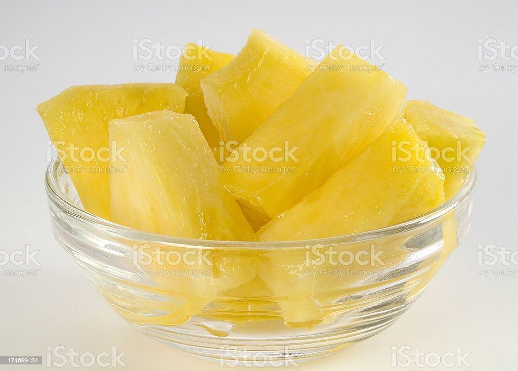 Pineapple chunks in a glass bowl stock photo