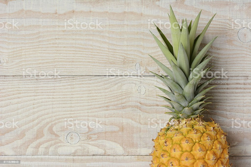 Pineapple Closeup on Wood stock photo