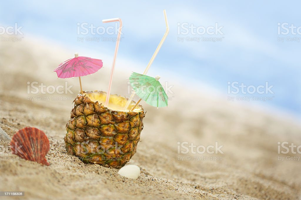 Pineapple Cocktail on the Beach stock photo