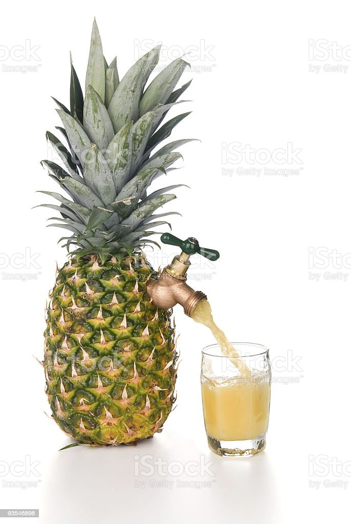 Pineapple juice pouring into glass stock photo