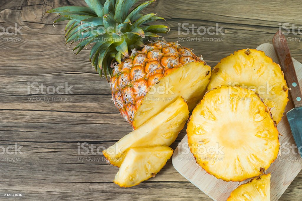pineapple on the wood texture background stock photo