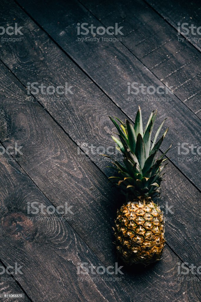 Pineapple on wood stock photo