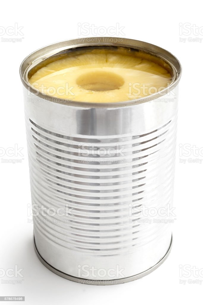 Pineapple rings in a tin in perspective isolated on white. stock photo