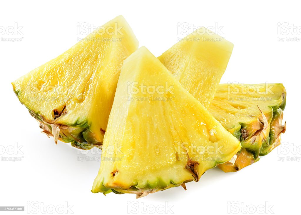 Pineapple slices isolated on white background. stock photo