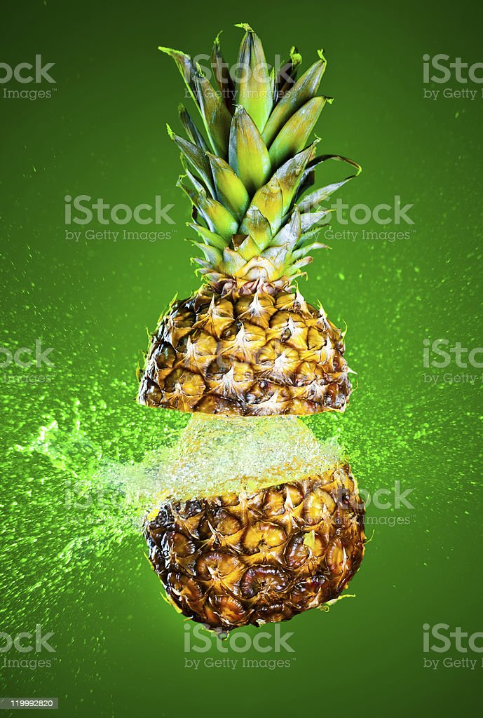 Pineapple splashed with water royalty-free stock photo