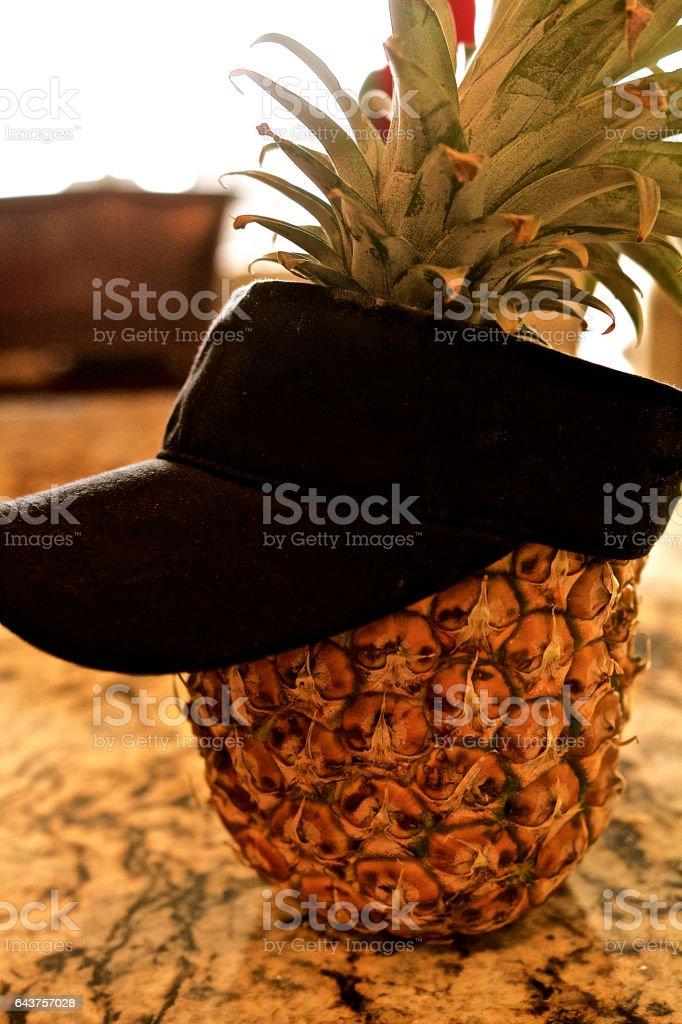 Pineapple wearing beach hat stock photo