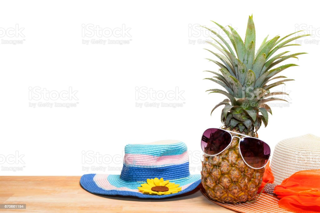 pineapple with sunglasses and hat beach on wood,concept summer background. stock photo