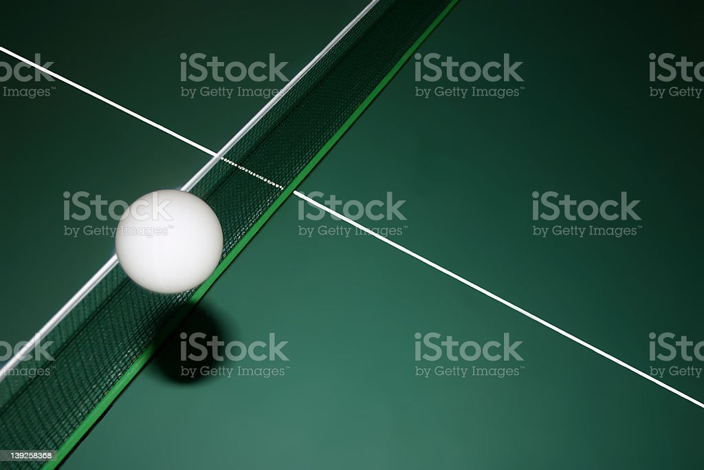 Ping pong ball flying across the border royalty-free stock photo
