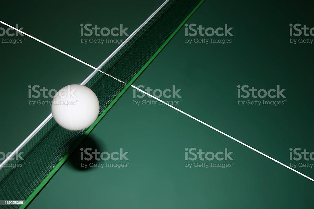 Ping pong ball flying across the border stock photo