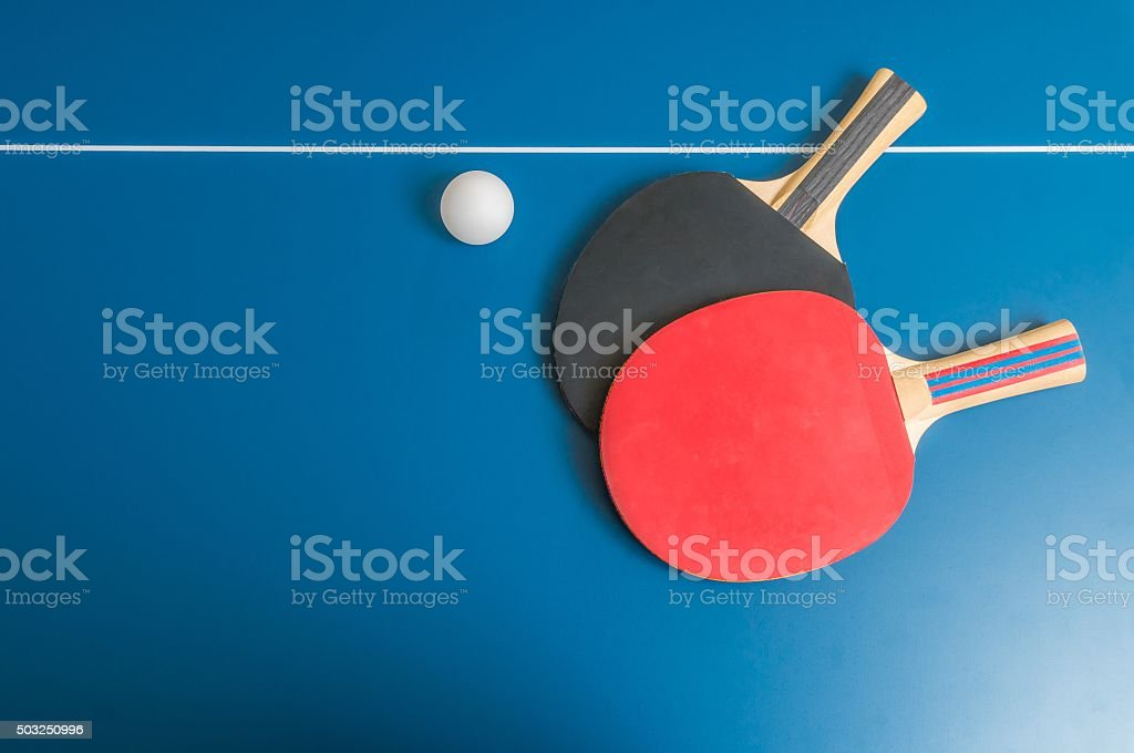 Ping pong or table tennis background with rackets stock photo