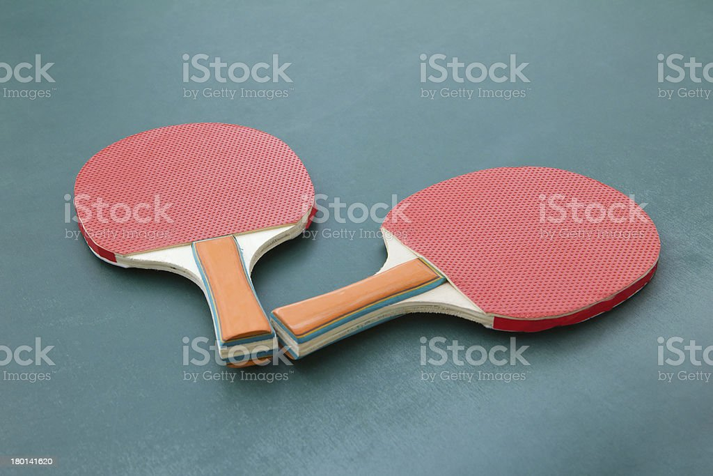 Ping pong paddles on a board royalty-free stock photo