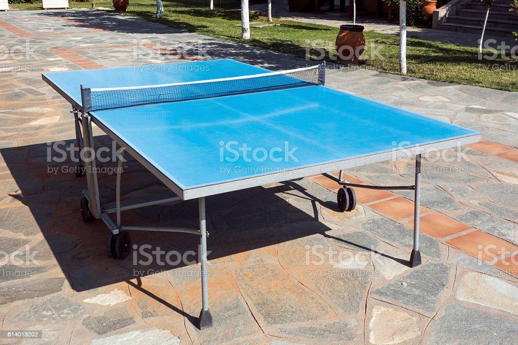 Ping pong table in garden stock photo