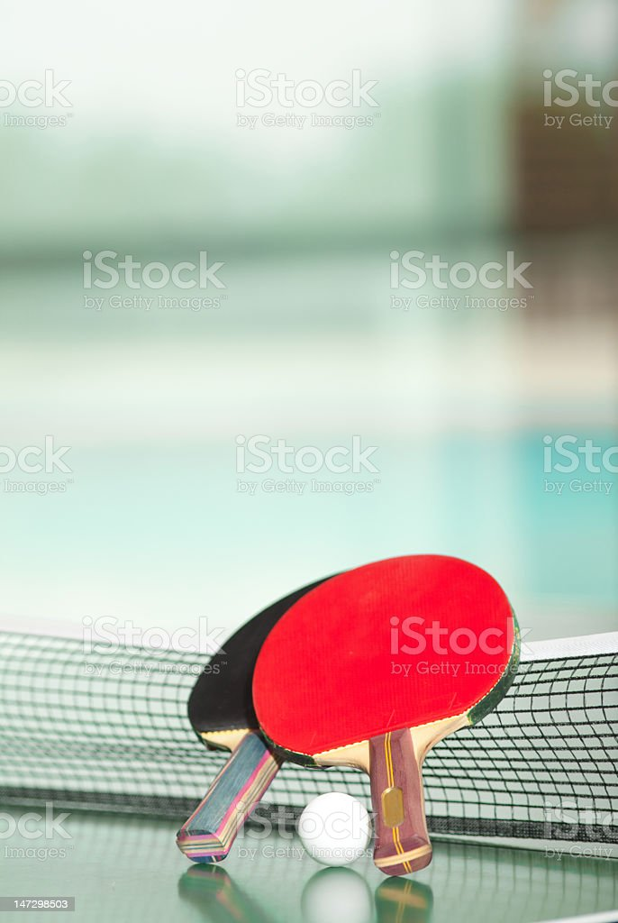 Ping-Pong rackets and ball on table royalty-free stock photo