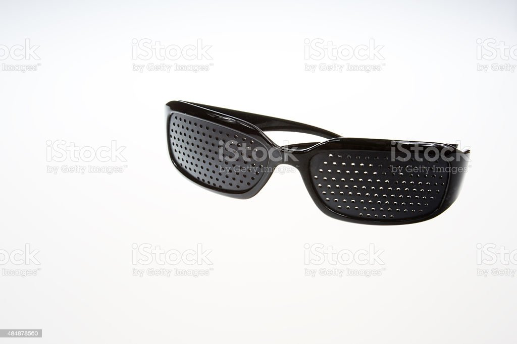 Pinhole Glasses on isolated white stock photo