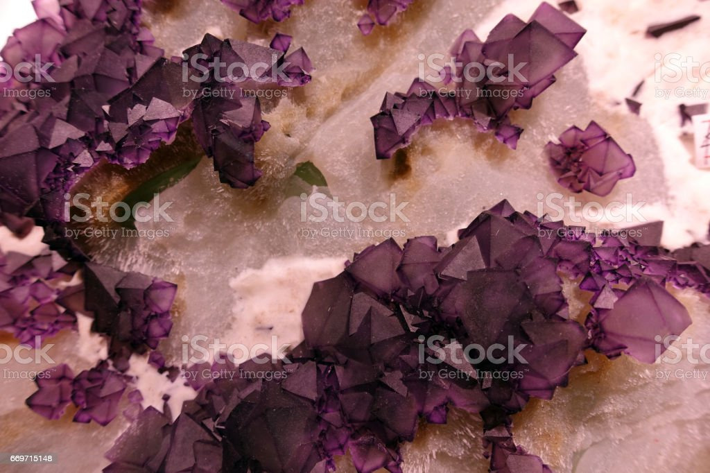 Pink amethyst crystals and other crystals stock photo