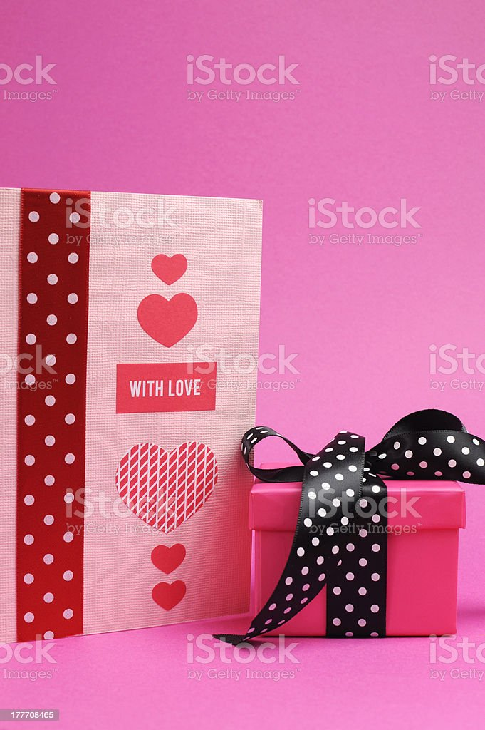 Pink and black polka dot gift with handmade card royalty-free stock photo