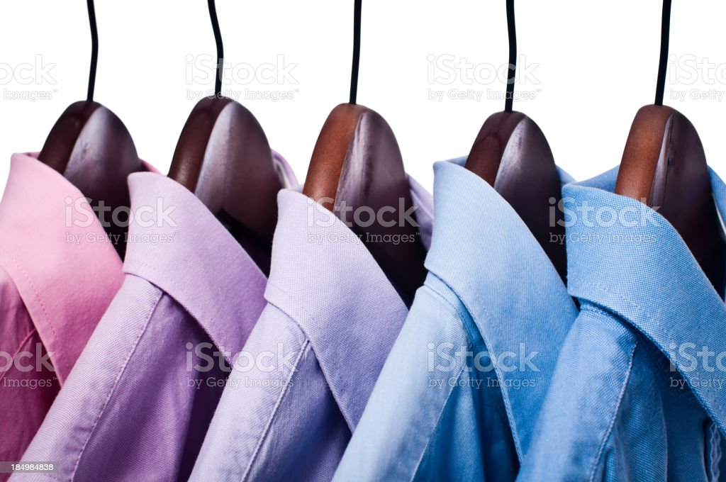Pink and blue button down shirts on hangers stock photo