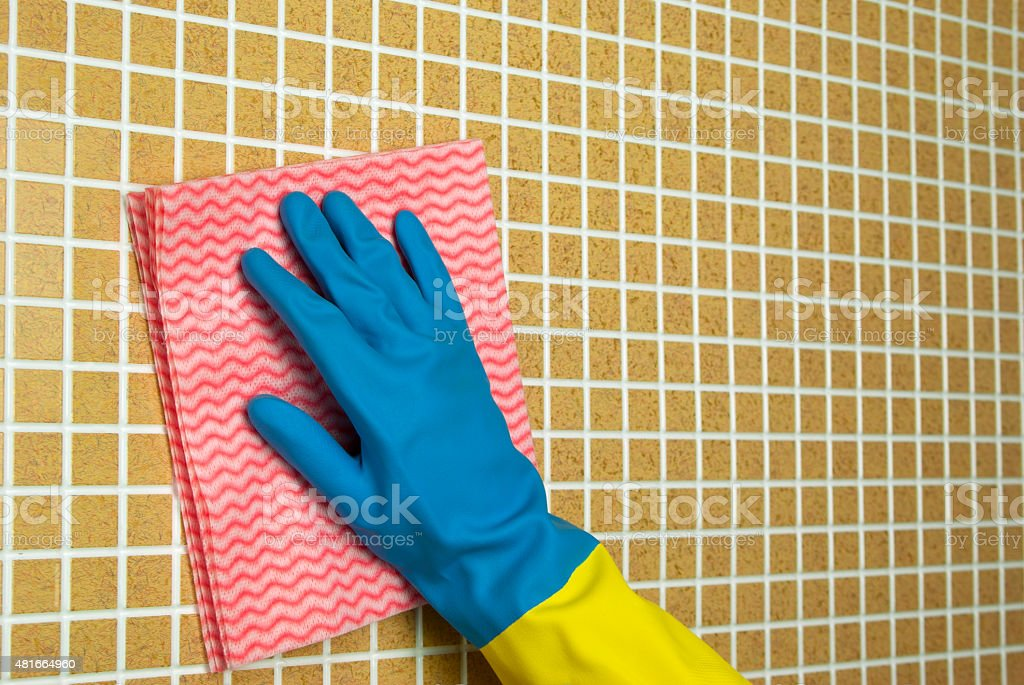 pink and blue cloth with yellow glove royalty-free stock photo