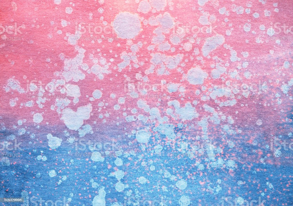 Pink and blue color gradient with paint splatters stock photo