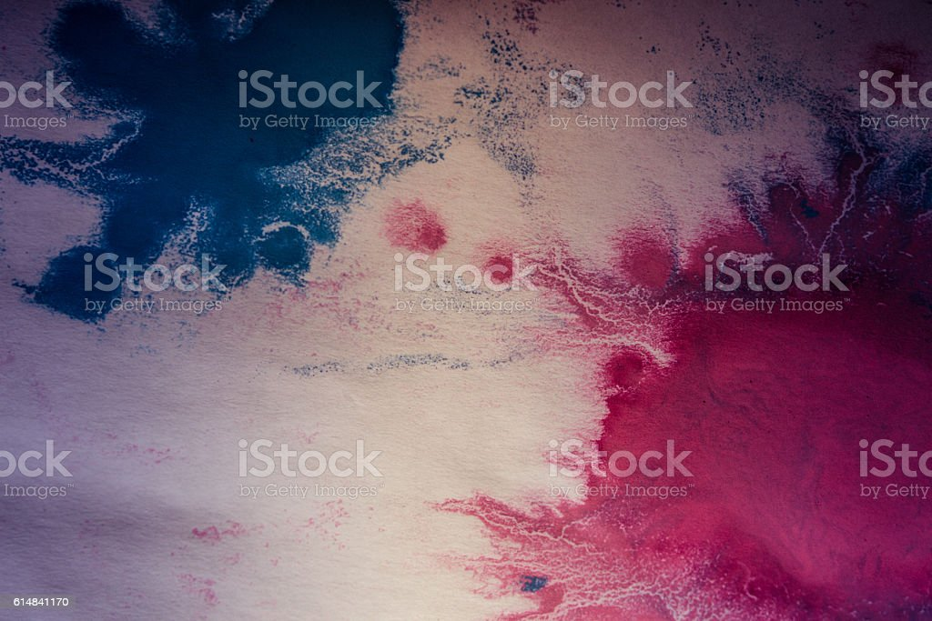 pink and blue flowed blots on white paper stock photo