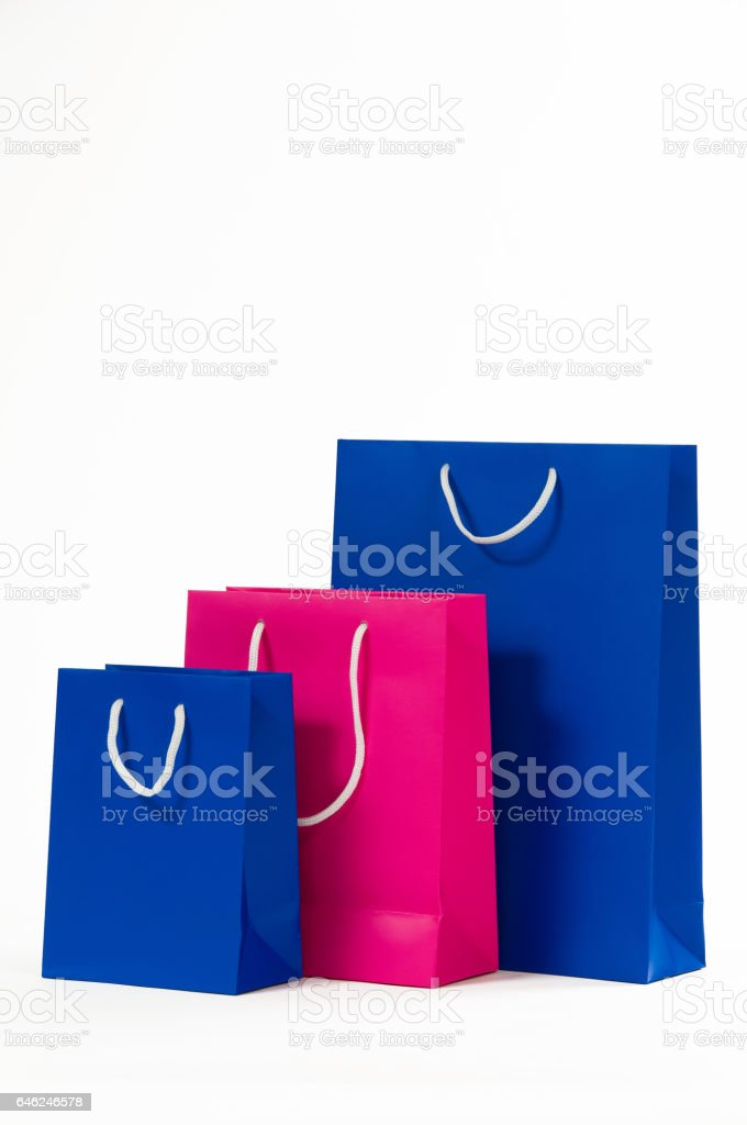 Pink and blue paper bag isolated on white background. stock photo