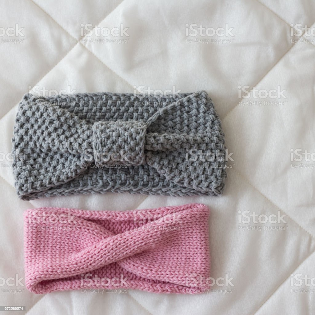 pink and gray bandage knit by hand on the spokes of natural soft wool stock photo