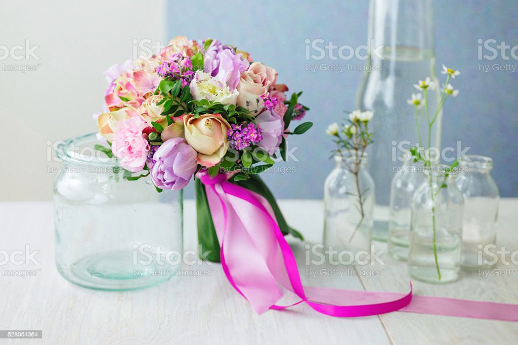 Pink and purple wedding bouquet with roses and tulips. stock photo
