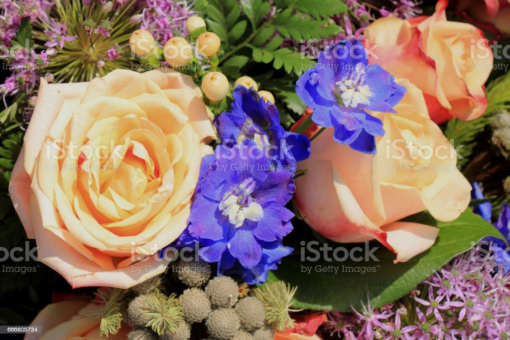 Pink roses and purple onions in a floral wedding decoration