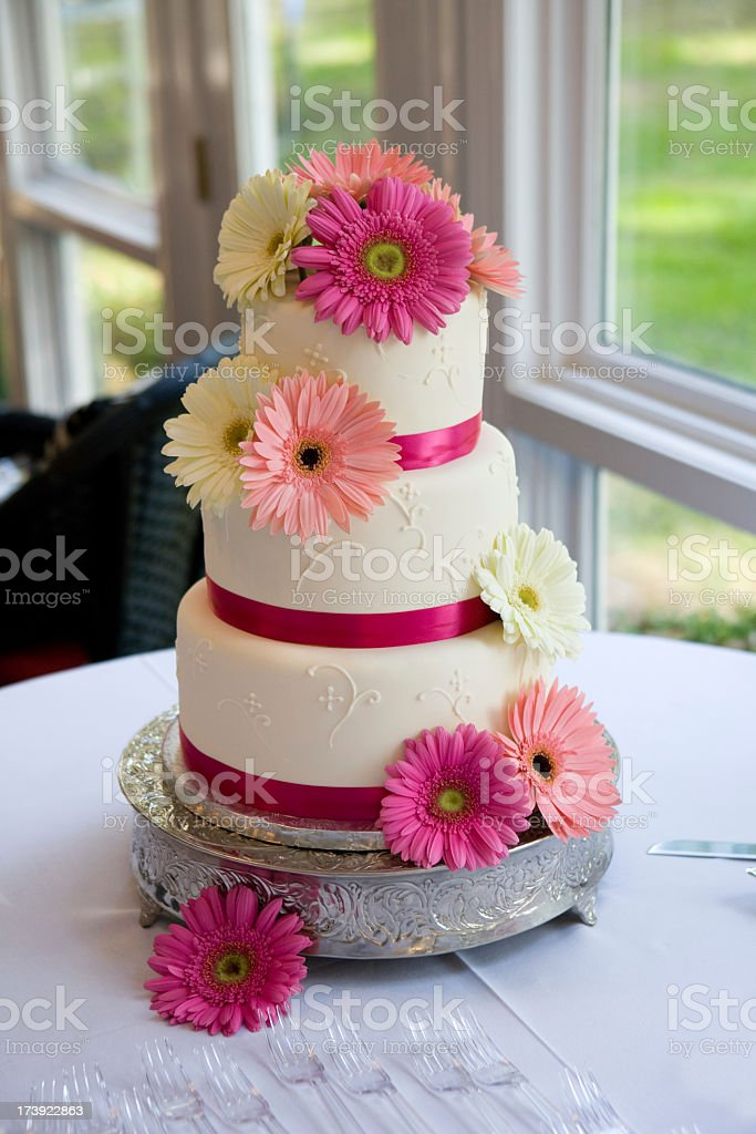 Pink and white floral wedding cake  stock photo
