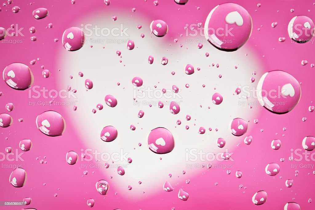Pink And White Heart Reflections In Water Droplets stock photo