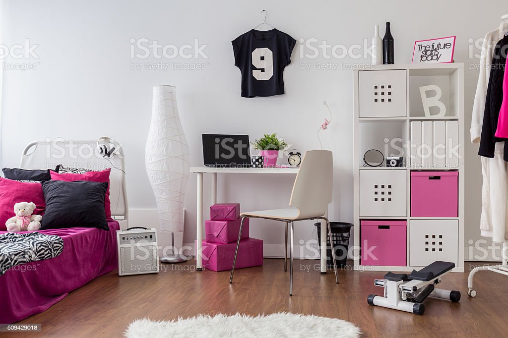 Pink and white room for sporty girl stock photo