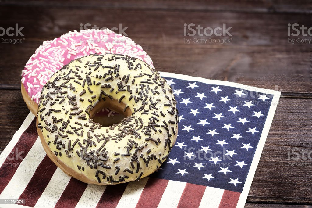 Pink and yellow american donuts stock photo