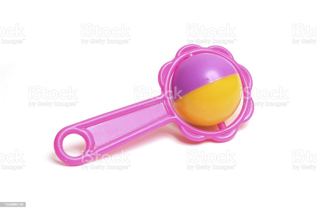 A pink and yellow toy on a white background stock photo